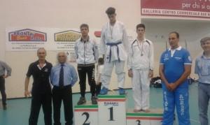 Andrea Longobucco, a sinistra nella foto, argento nella finale regionale di Karate